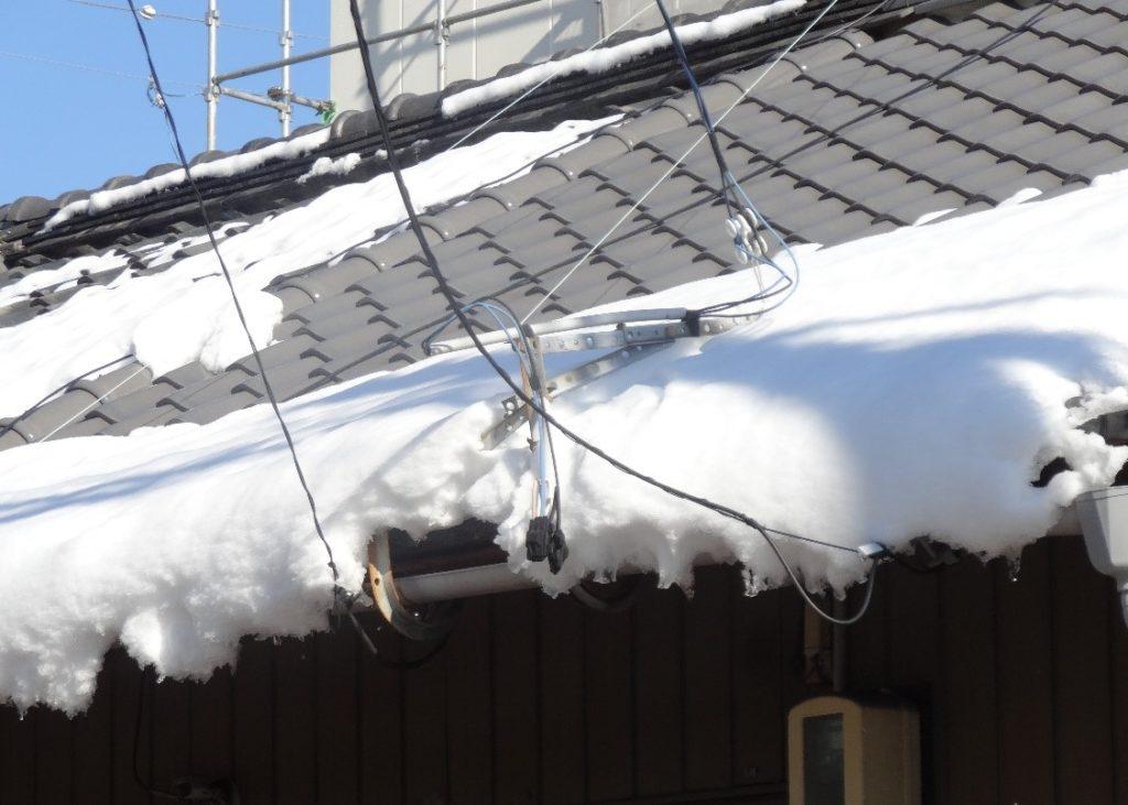 堆雪で雨漏りしている写真(塗装工房)