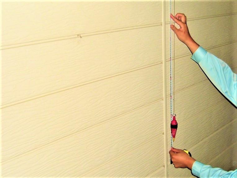 住宅の傾き検査の写真(塗装工房)